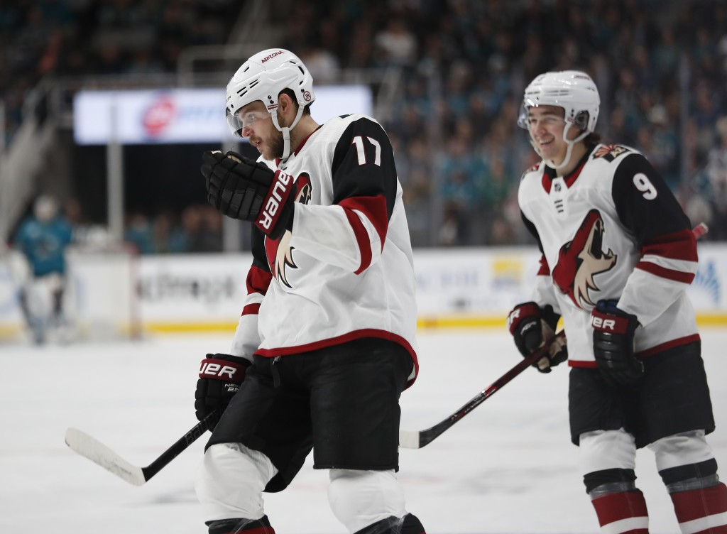 Arizona Coyotes' Alex Galchenyuk (17) and Clayton Keller (9) celebrate after scoring against the San Jose Sharks in the first period of an NHL hockey ...
