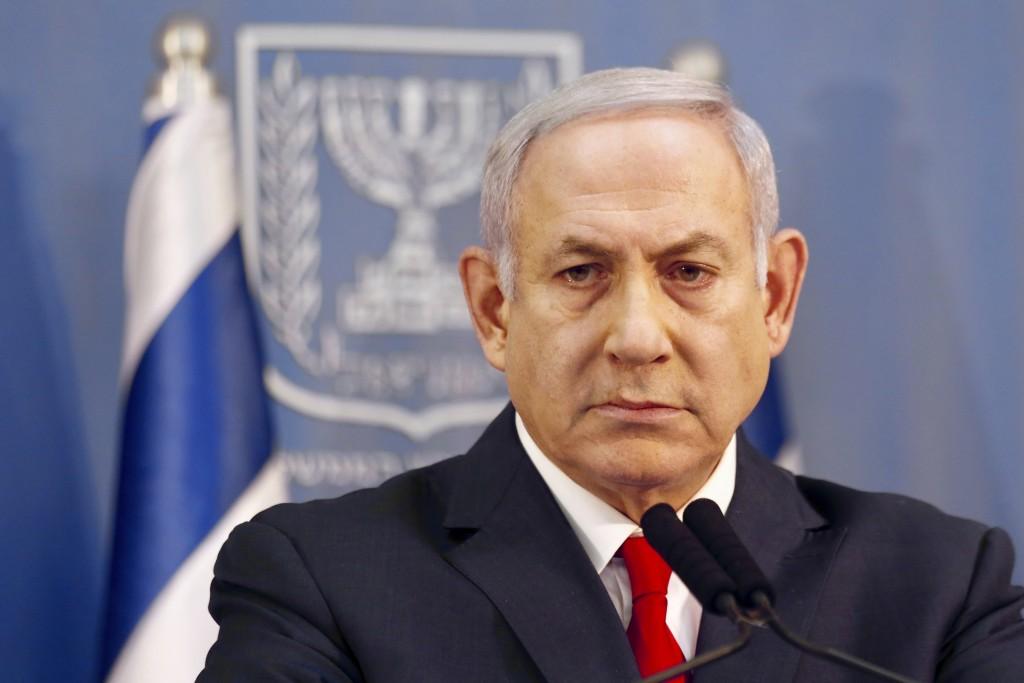 FILE - In this Nov. 18, 2018 file photo, Israeli Prime Minister Benjamin Netanyahu delivers a statement in Tel Aviv, Israel. Israeli media is reportin...