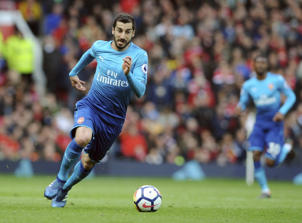 FILE - In this Sunday, April 29, 2018 file photo, Arsenal's Henrikh Mkhitaryan runs with the ball during their English Premier League soccer match aga...