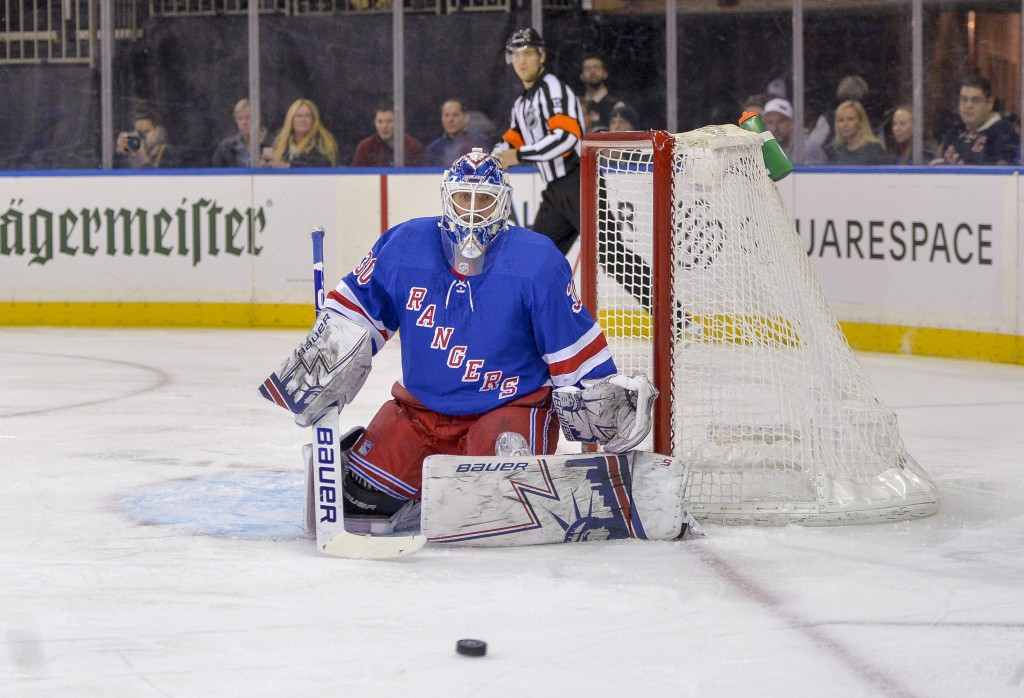 New York Rangers goaltender Henrik Lundqvist (30) keeps an eye on the puck during the first period of an NHL hockey game against the Philadelphia Flye...
