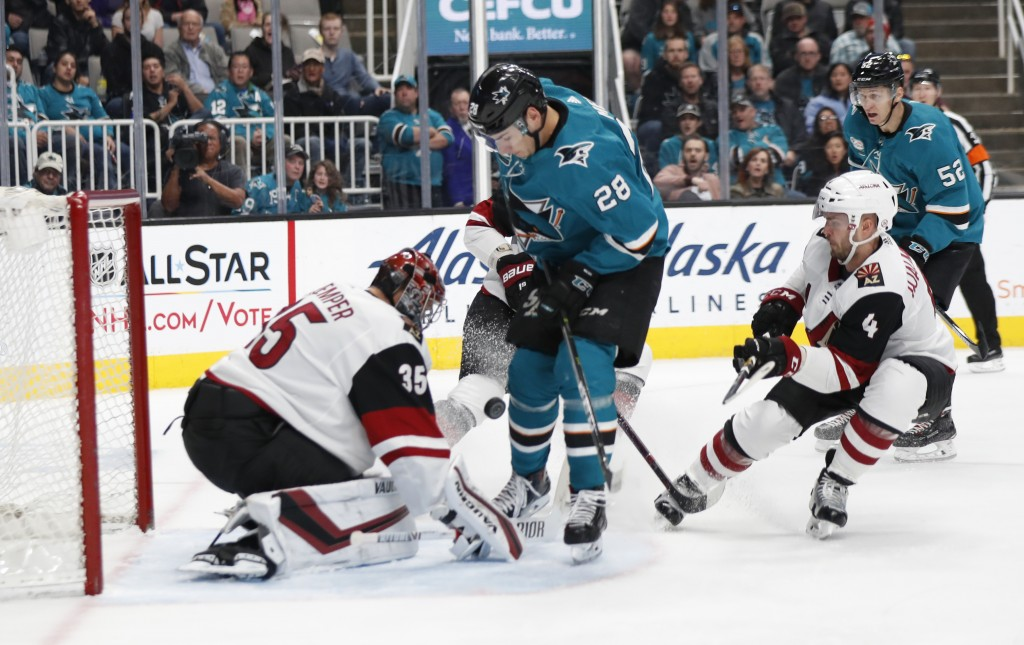 Arizona Coyotes' Darcy Kuemper (35) makes a save against the San Jose Sharks' Timo Meier (28) in the first period of an NHL hockey game in San Jose, C...