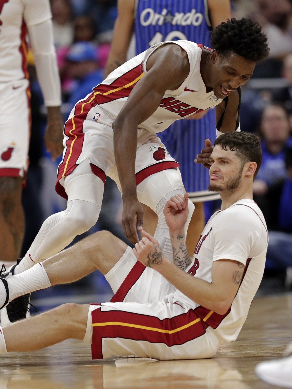 Miami Heat's Tyler Johnson, right, pumps his fists after making a three-point basket against the Orlando Magic and drawing a foul as teammate Josh Ric...
