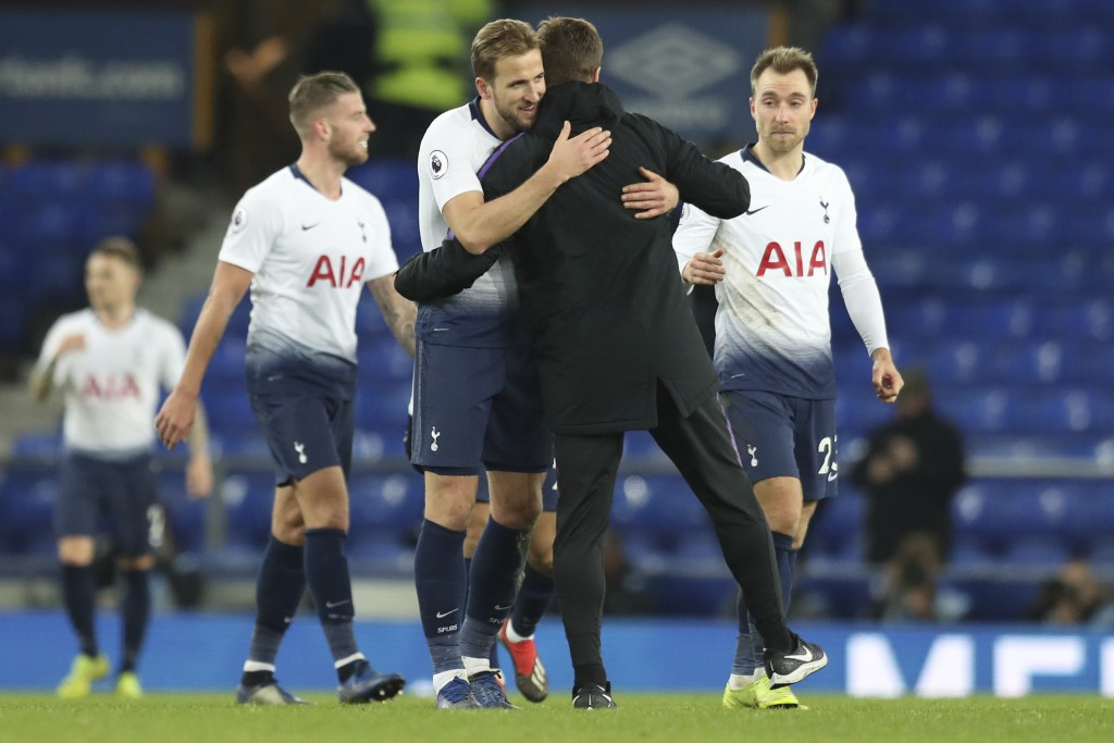 Tottenham's Harry Kane, left, hugs Tottenham coach Mauricio Pochettino at the end of the English Premier League soccer match between Everton and Totte...