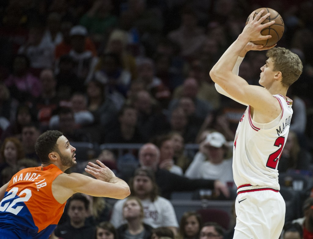 Chicago Bulls' Lauri Markkanen, right, shoots over Cleveland Cavaliers' Larry Nance Jr. (22) during the second half of an NBA basketball game in Cleve