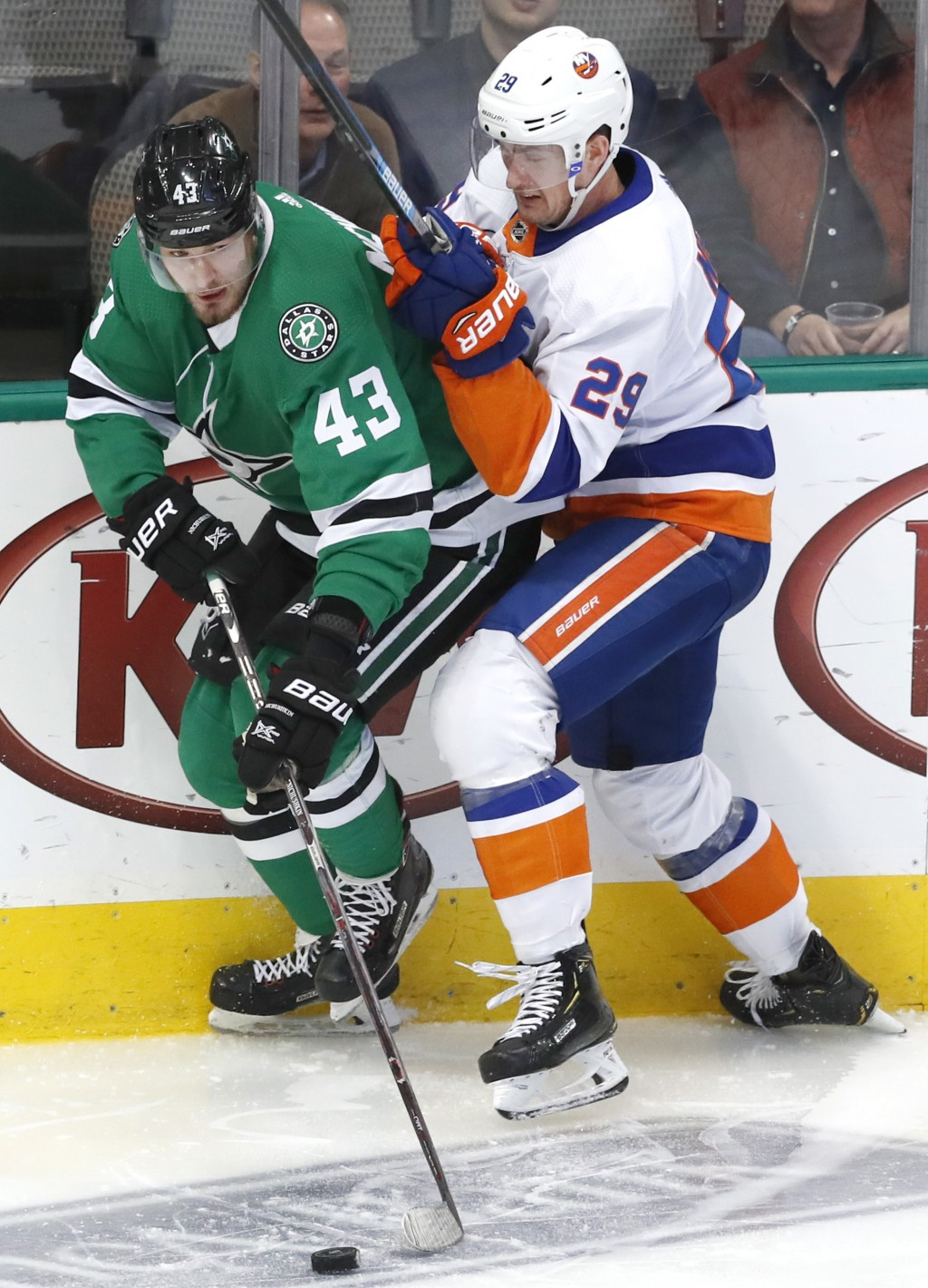 New York Islanders center Brock Nelson (29) and Dallas Stars right wing Valeri Nichushkin (43) vie for control of the puck during the first period of ...