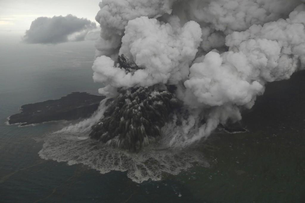 This aerial shot taken on Sunday, Dec. 23, 2018 shows Mount Anak Krakatau as it erupts on Java Strait, Indonesia. Doctors worked to save injured victi...