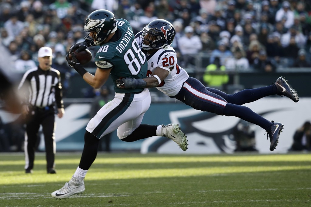 Philadelphia Eagles' Dallas Goedert (88) pulls in a pass against Houston Texans' Justin Reid (20) during the second half of an NFL football game, Sund...