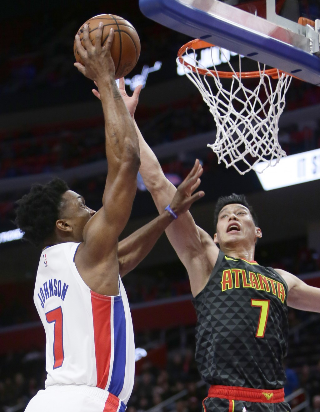Atlanta Hawks guard Jeremy Lin, right, defends against a shot by Detroit Pistons forward Stanley Johnson, left, during the first half on an NBA basket