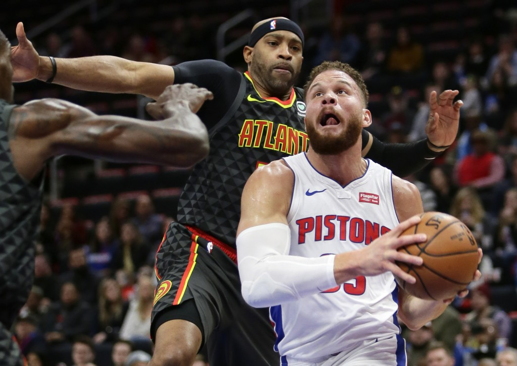 Detroit Pistons forward Blake Griffin (23) goes to the basket past Atlanta Hawks forward Vince Carter during the first half on an NBA basketball game ...