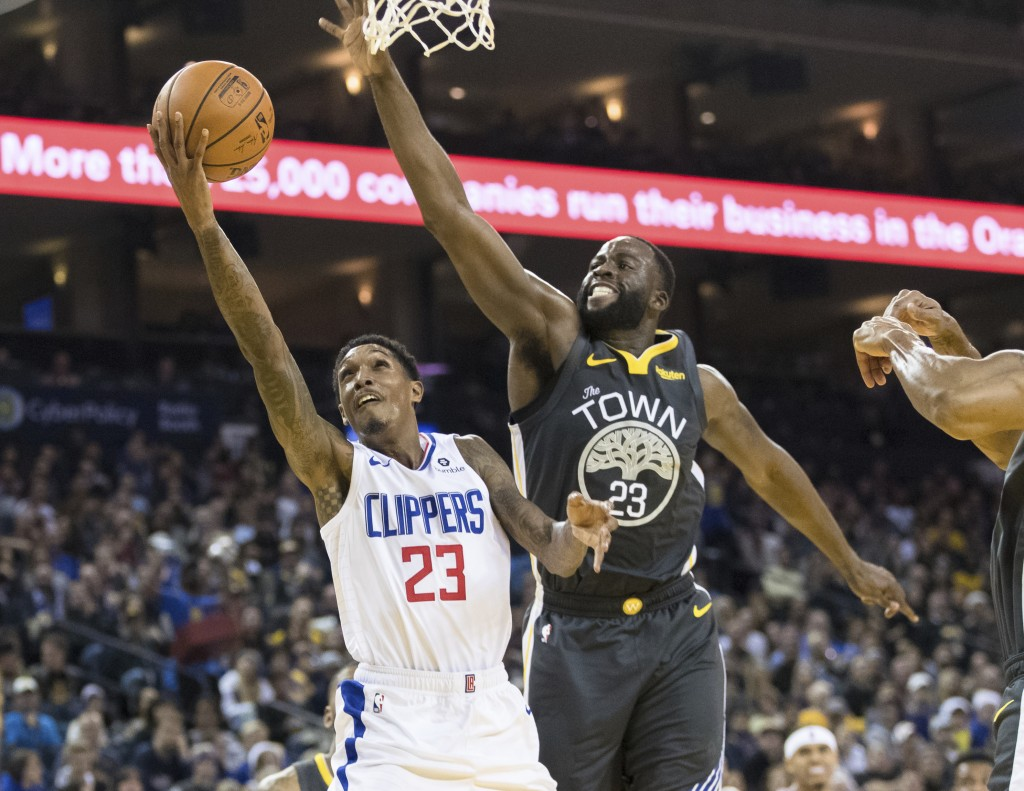 Los Angeles Clippers guard Lou Williams (23) shoots as Golden State Warriors forward Draymond Green (23) defends in the second quarter of an NBA baske...