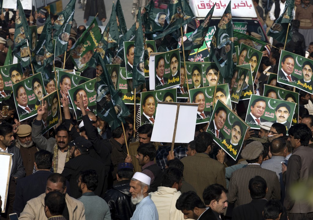 Supporters of former Pakistani Prime Minister Nawaz Sharif gather outside an accountability court in Islamabad, Pakistan, Monday, Dec. 24, 2018. Pakis...
