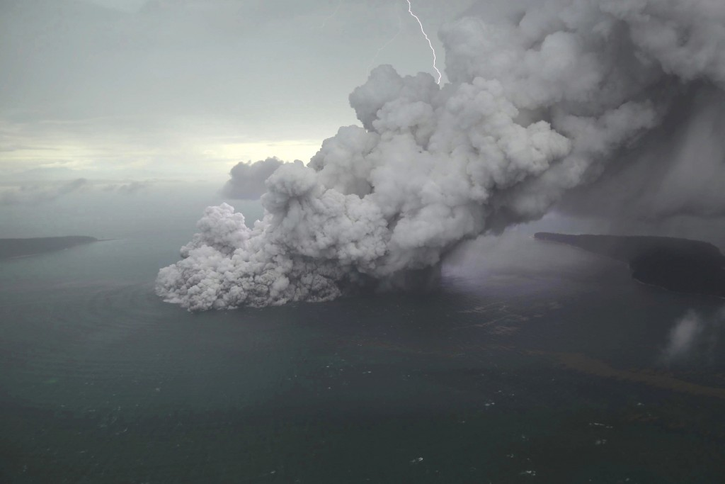 This aerial shot taken on Sunday, Dec. 23, 2018, shows volcanic material spew from the crater of Mount Anak Krakatau as it erupts on Java Strait, Indo...