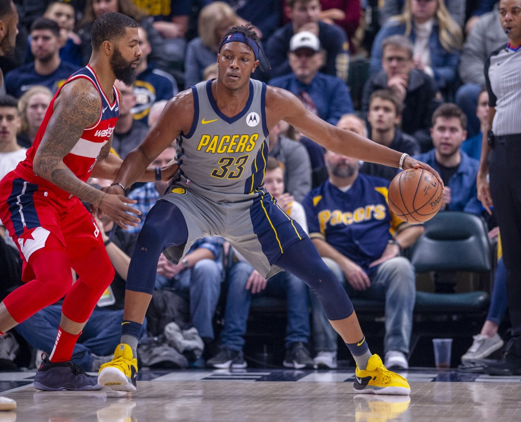 Indiana Pacers center Myles Turner (33) works the ball toward the basket against the defense of Washington Wizards forward Markieff Morris (5) during ...