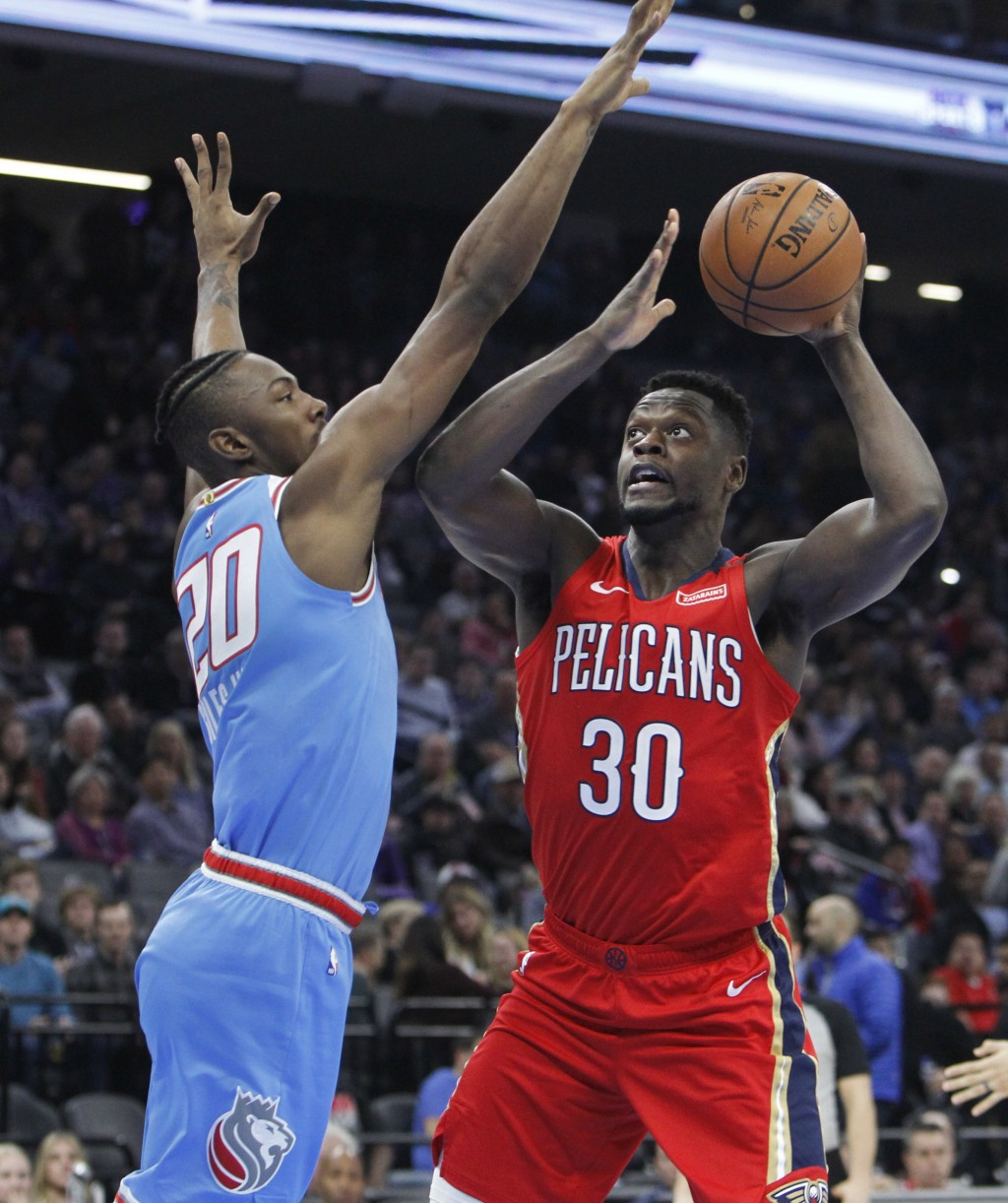 New Orleans Pelicans forward Julius Randle (30) shoots over Sacramento Kings forward Harry Giles (20) during the first half of an NBA basketball game ...