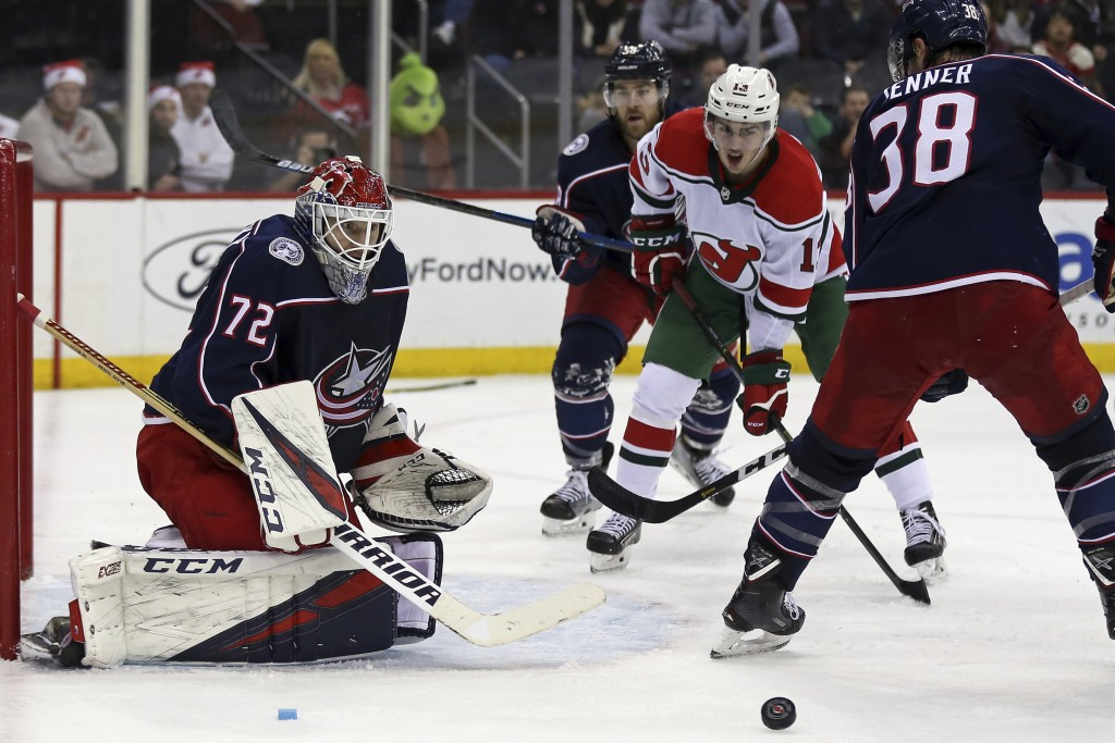 Columbus Blue Jackets goaltender Sergei Bobrovsky (72) watches a deflection from a shot by New Jersey Devils center Nico Hischier (13) during the seco...