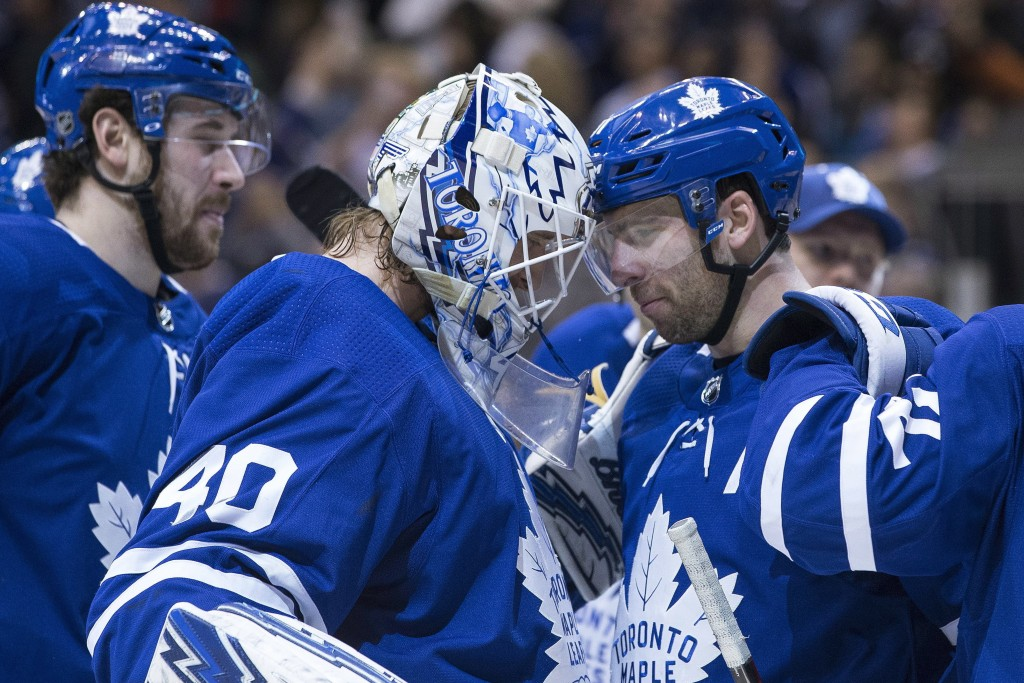Toronto Maple Leafs John Tavares, right, congratulates goaltender Garret Sparks after their overtime win over the Detroit Red Wings in NHL hockey game...