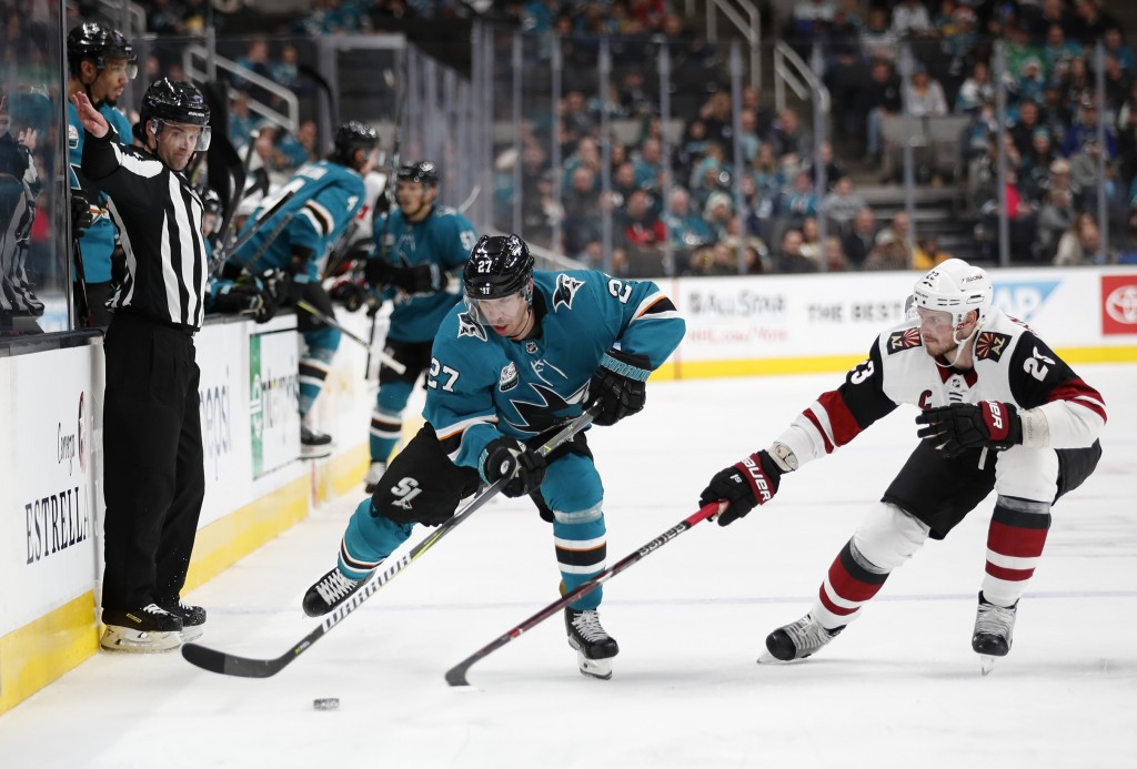 San Jose Sharks' Joonas Donskoi (27) battles for the puck against the Arizona Coyotes' Oliver Ekman-Larsson (23) in the second period of an NHL hockey...