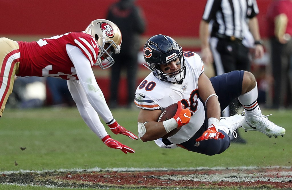 Chicago Bears tight end Trey Burton (80) falls forward in front of San Francisco 49ers cornerback D.J. Reed Jr. during the second half of an NFL footb...