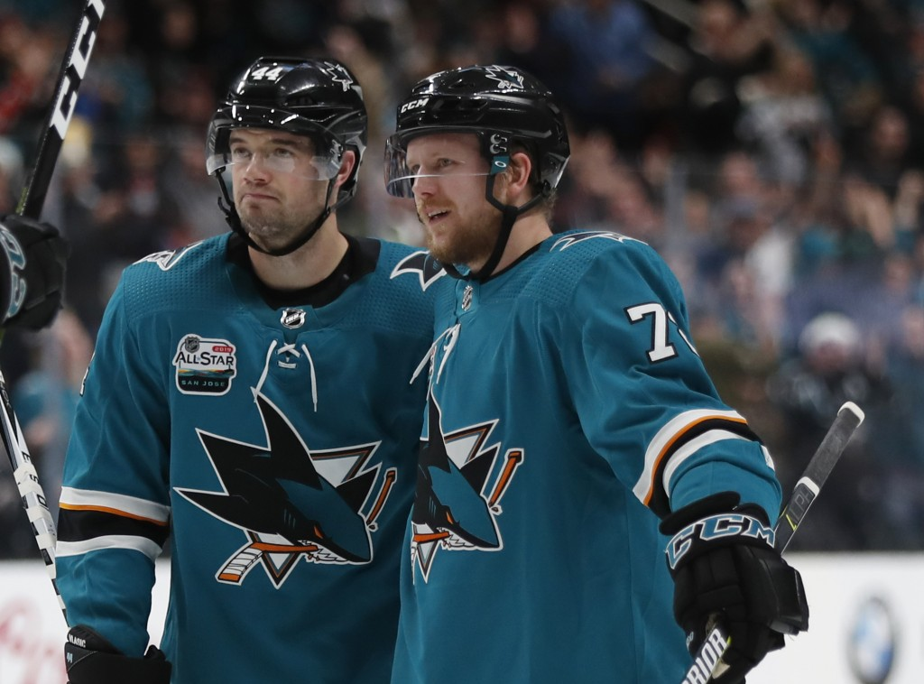 San Jose Sharks' Marc-Edouard Vlasic (44) and Tim Heed (72) celebrate goal against the Arizona Coyotes in the first period of an NHL hockey game in Sa