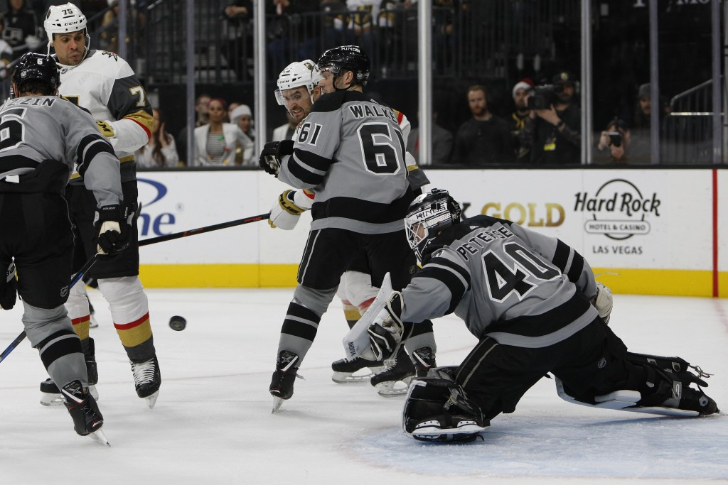 Los Angeles Kings goaltender Calvin Petersen (40) goes for a save against the Vegas Golden Knights during the second period of an NHL hockey game Sund...