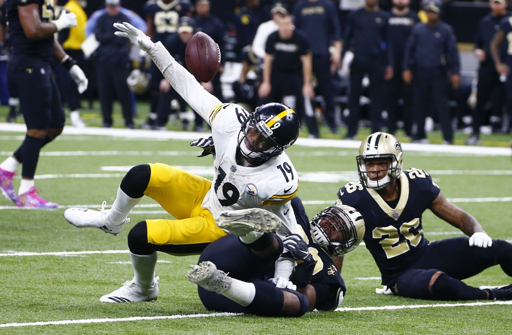 Pittsburgh Steelers wide receiver JuJu Smith-Schuster (19) fumbles the ball as New Orleans Saints defensive tackle Sheldon Rankins tackles him, causin