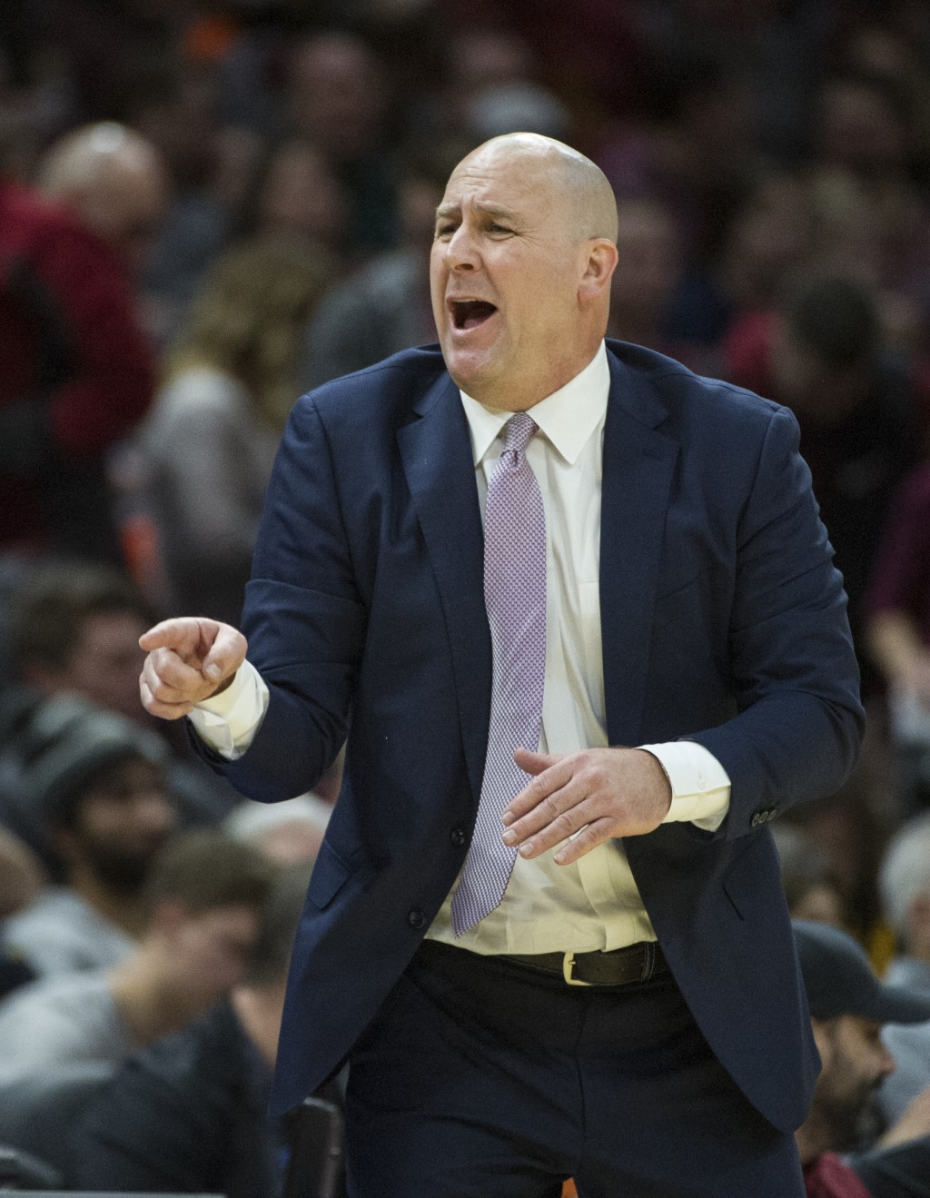 Chicago Bulls head coach Jim Boylen directs his team against the Cleveland Cavaliers during the second half of an NBA basketball game in Cleveland, Su...