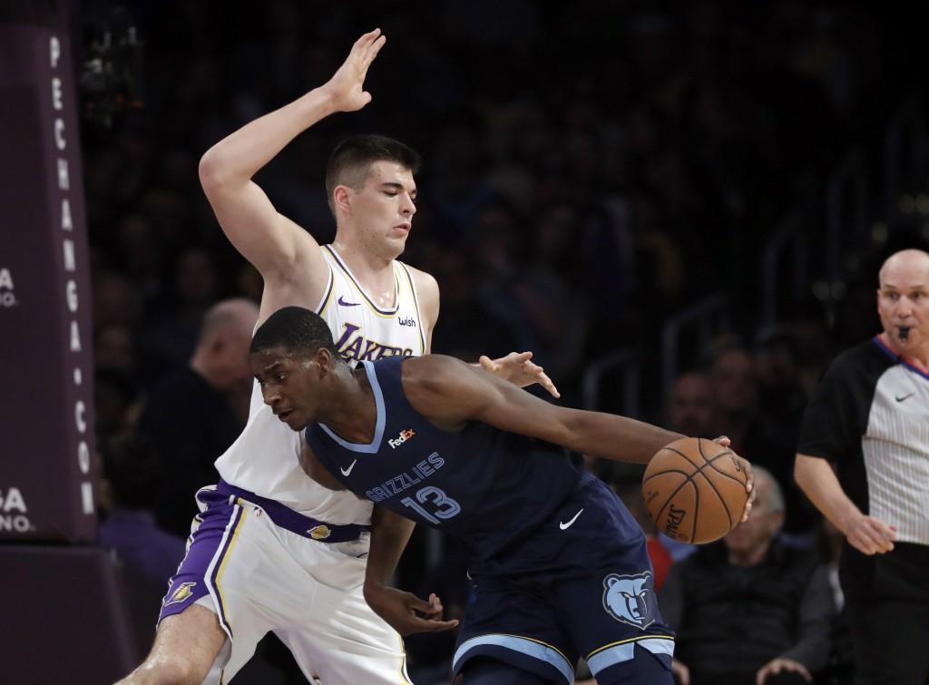 Memphis Grizzlies' Jaren Jackson Jr., right, is defended by Los Angeles Lakers' Ivica Zubac during the first half of an NBA basketball game Sunday, De...
