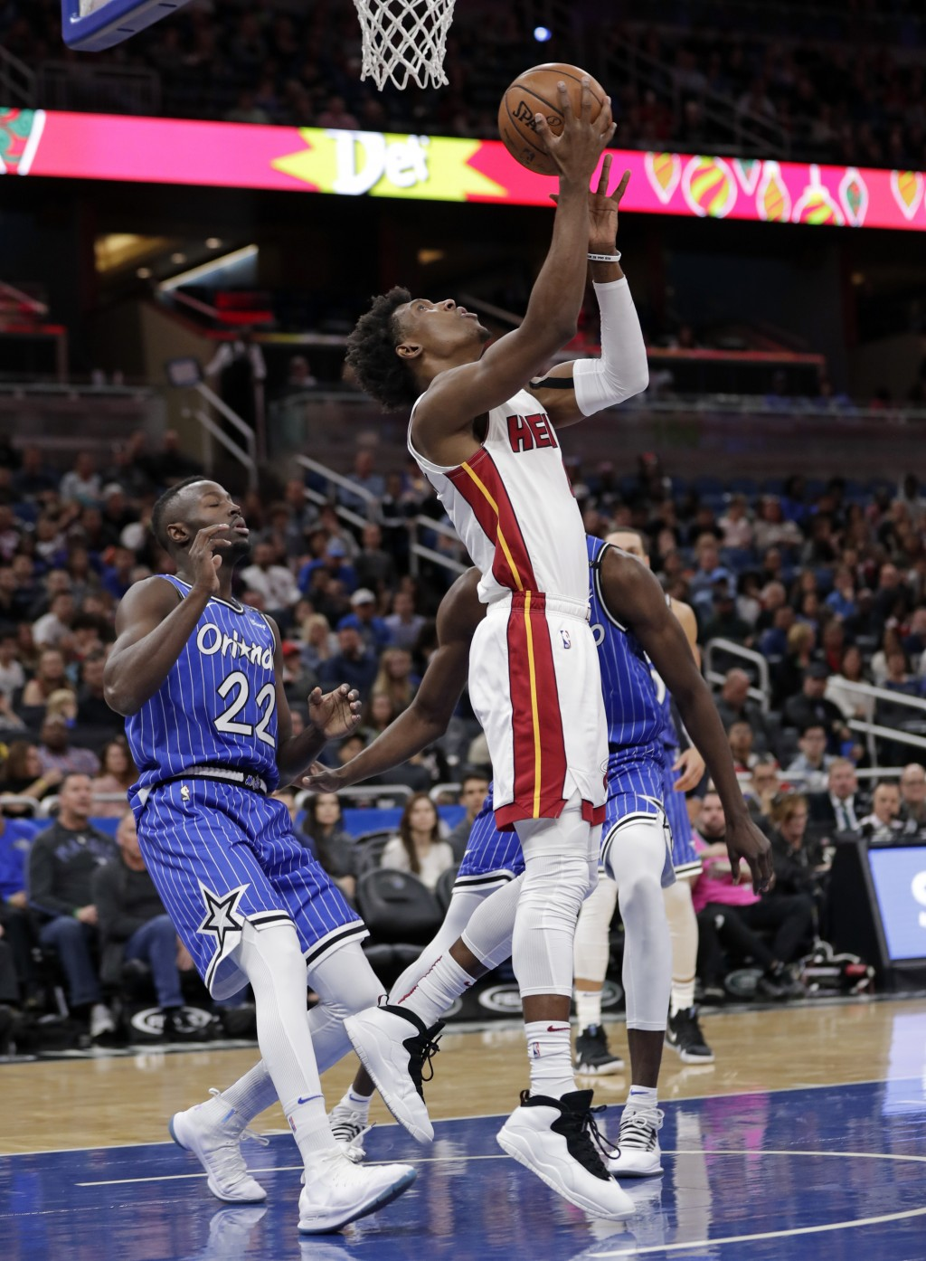 Miami Heat's Josh Richardson, front right, takes a shot in front of Orlando Magic's Jerian Grant (22) during the first half of an NBA basketball game,...