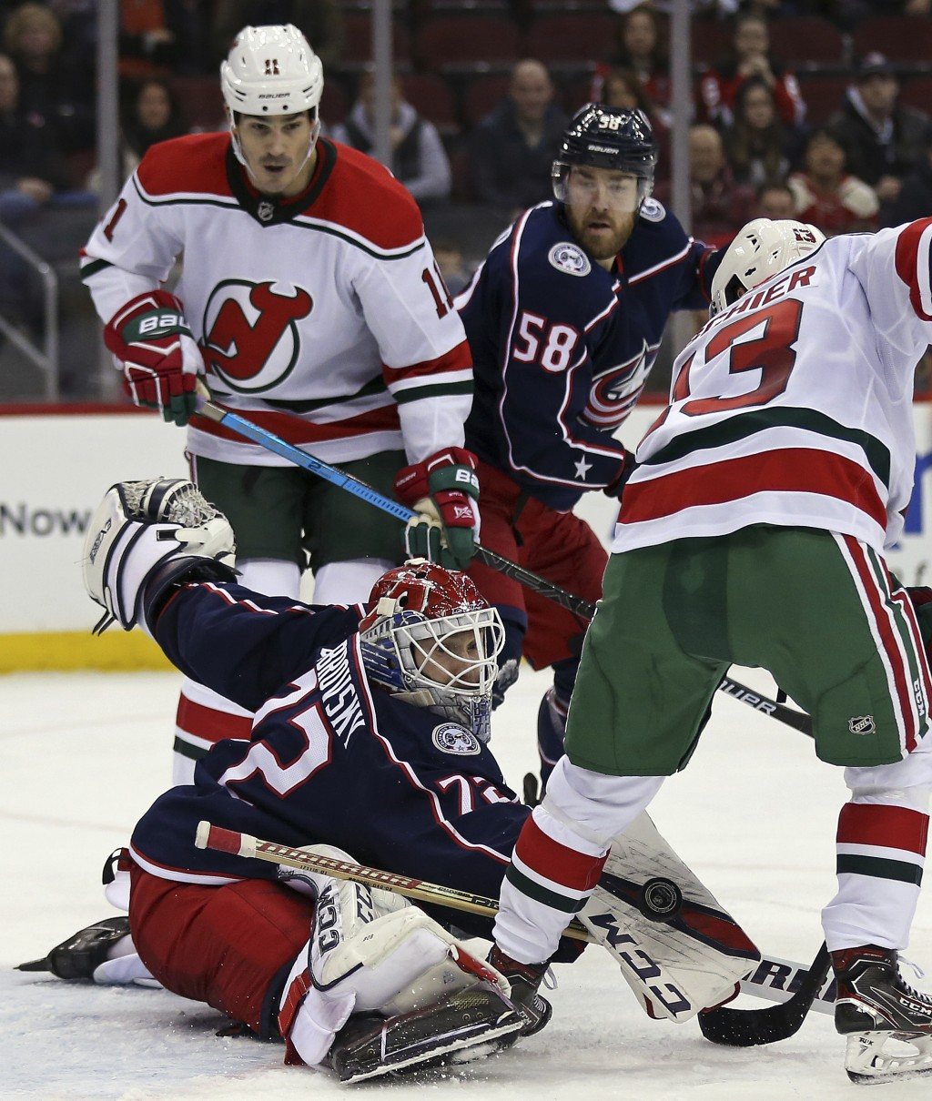 Columbus Blue Jackets goaltender Sergei Bobrovsky (72) makes a pad save on a shot by New Jersey Devils center Nico Hischier (13) during the second per...