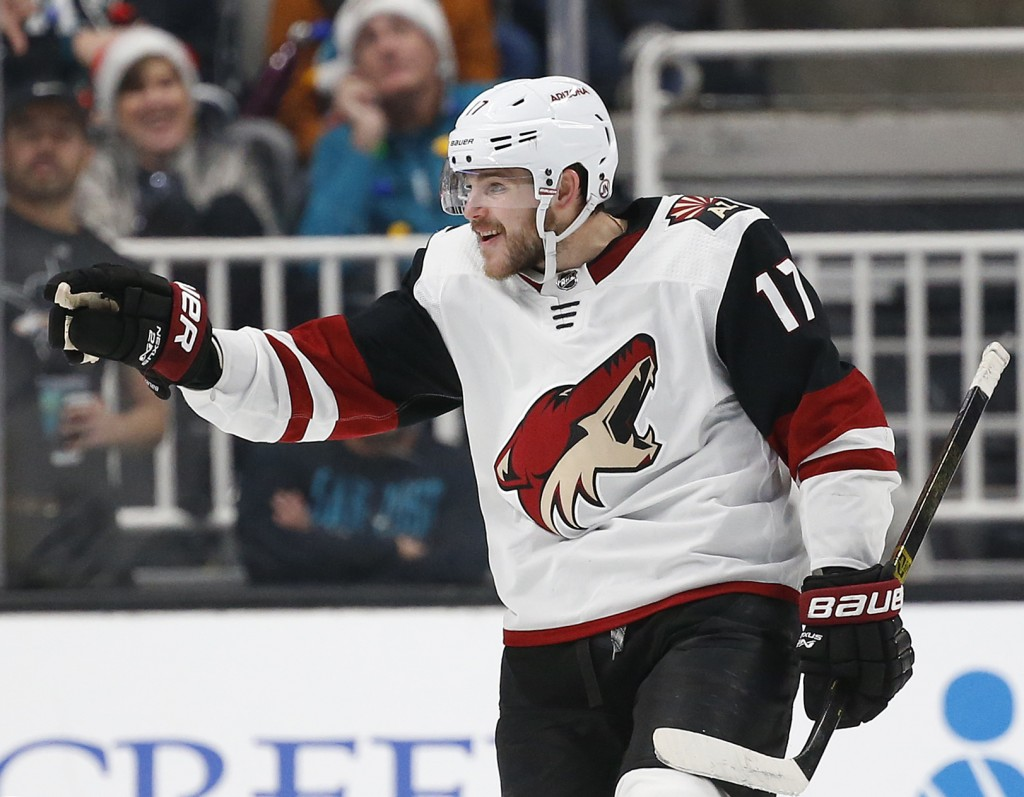 Arizona Coyotes' Alex Galchenyuk (17) celebrates after scoring his second goal of the night against the San Jose Sharks in the second period of an NHL...