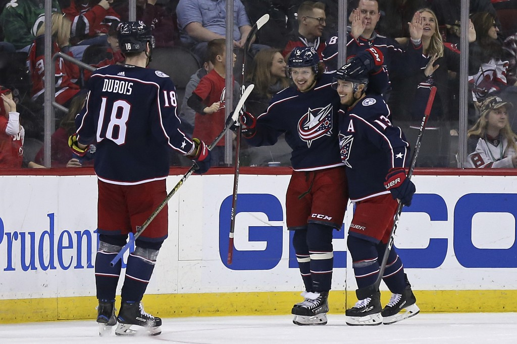 Columbus Blue Jackets' Artemi Panarin celebrates scoring a goal with teammates Blue Jackets' Cam Atkinson (13) and Blue Jackets' Pierre-Luc Dubois (18...