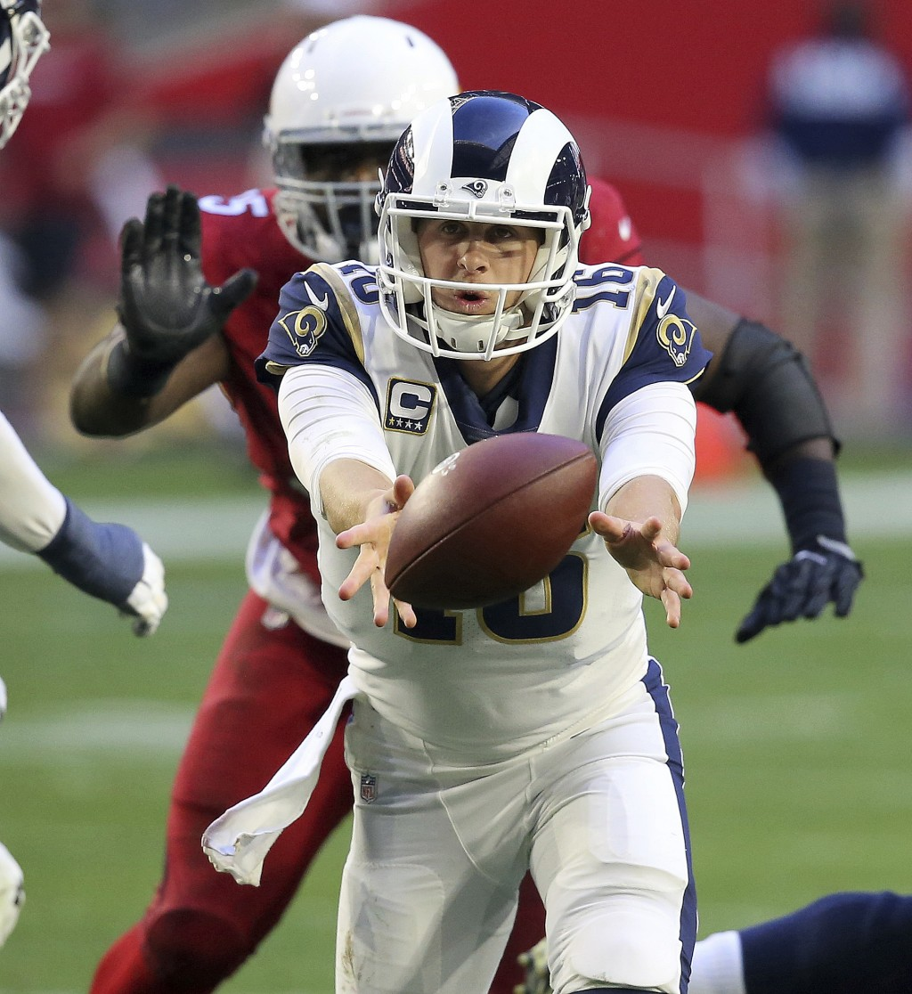 Los Angeles Rams quarterback Jared Goff (16) hands off against the Arizona Cardinals during the second half of an NFL football game, Sunday, Dec. 23, ...