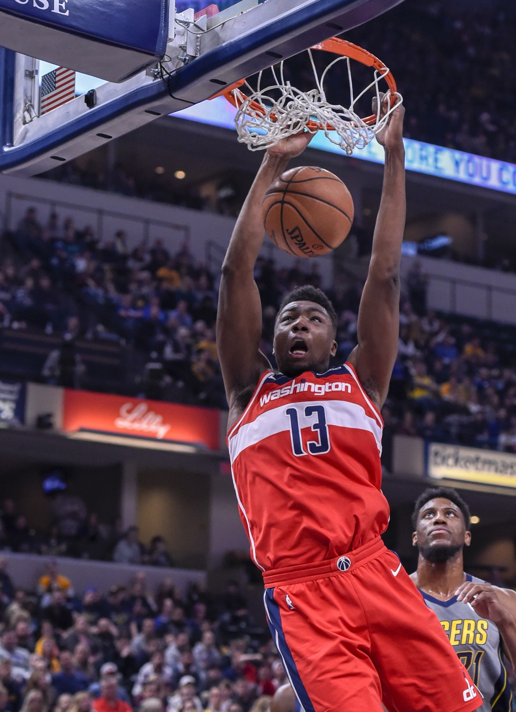 Washington Wizards center Thomas Bryant (13) slam-dunks the ball during an NBA basketball game against the Indiana Pacers, Sunday, Dec. 23, 2018, in I