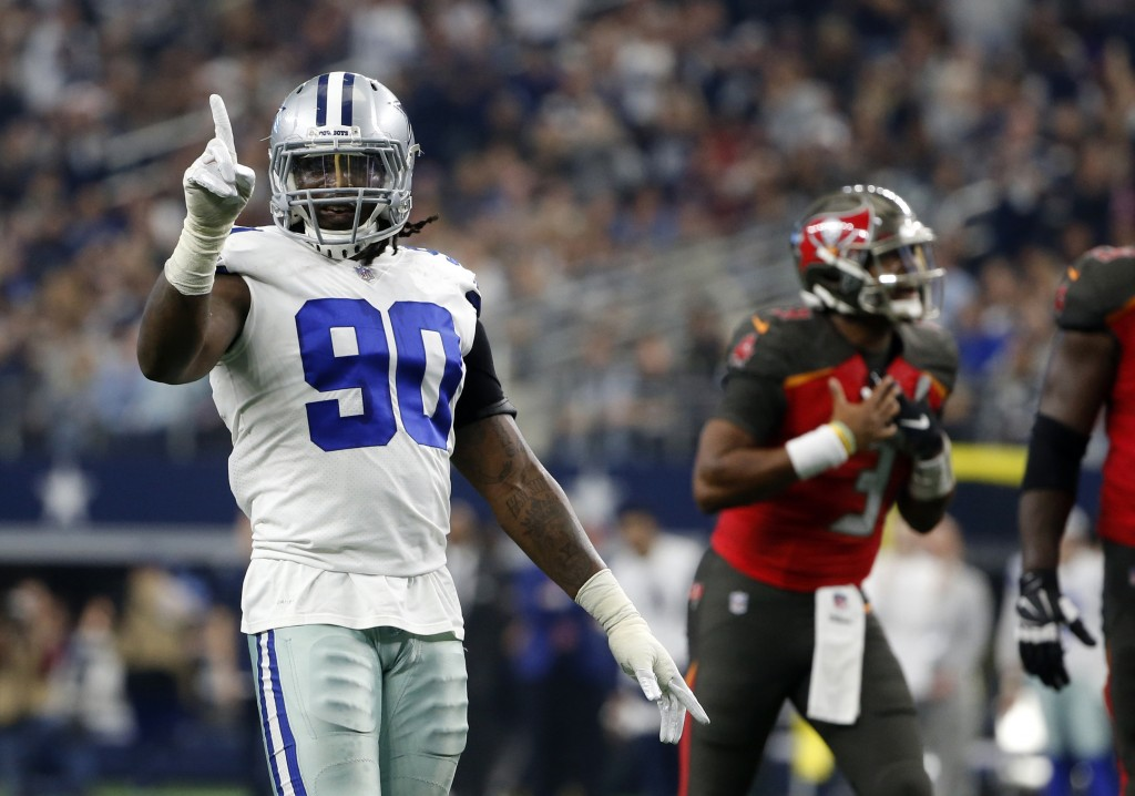 Dallas Cowboys defensive end DeMarcus Lawrence (90) celebrates as Tampa Bay Buccaneers quarterback Jameis Winston shouts in the direction of an offici...
