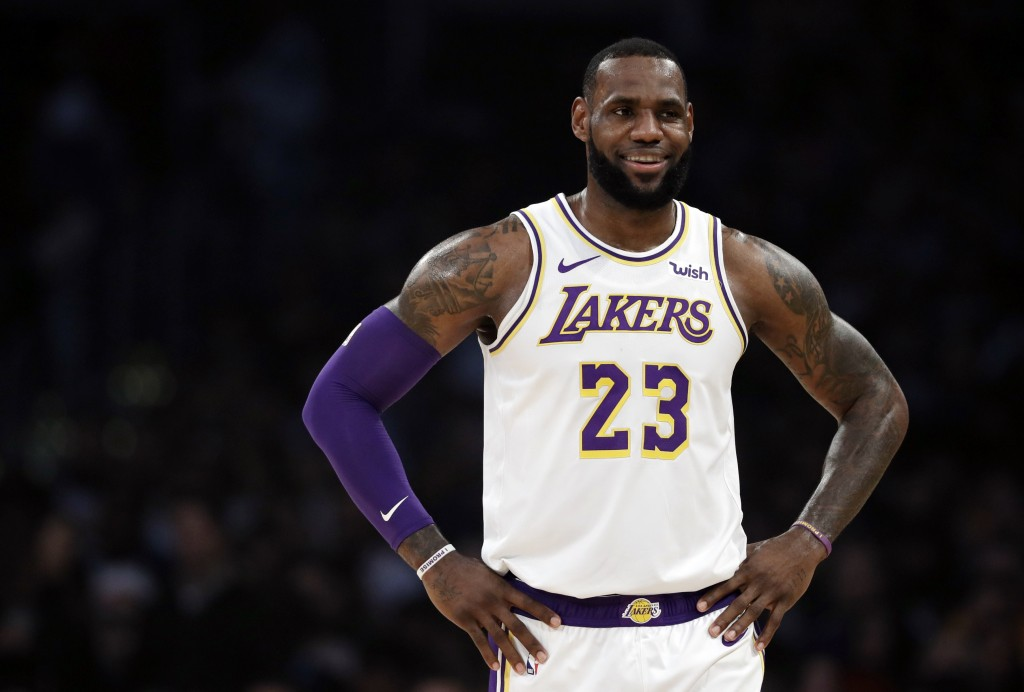 Los Angeles Lakers' LeBron James (23) smiles during a break in action during the first half of an NBA basketball game against the Memphis Grizzlies Su...