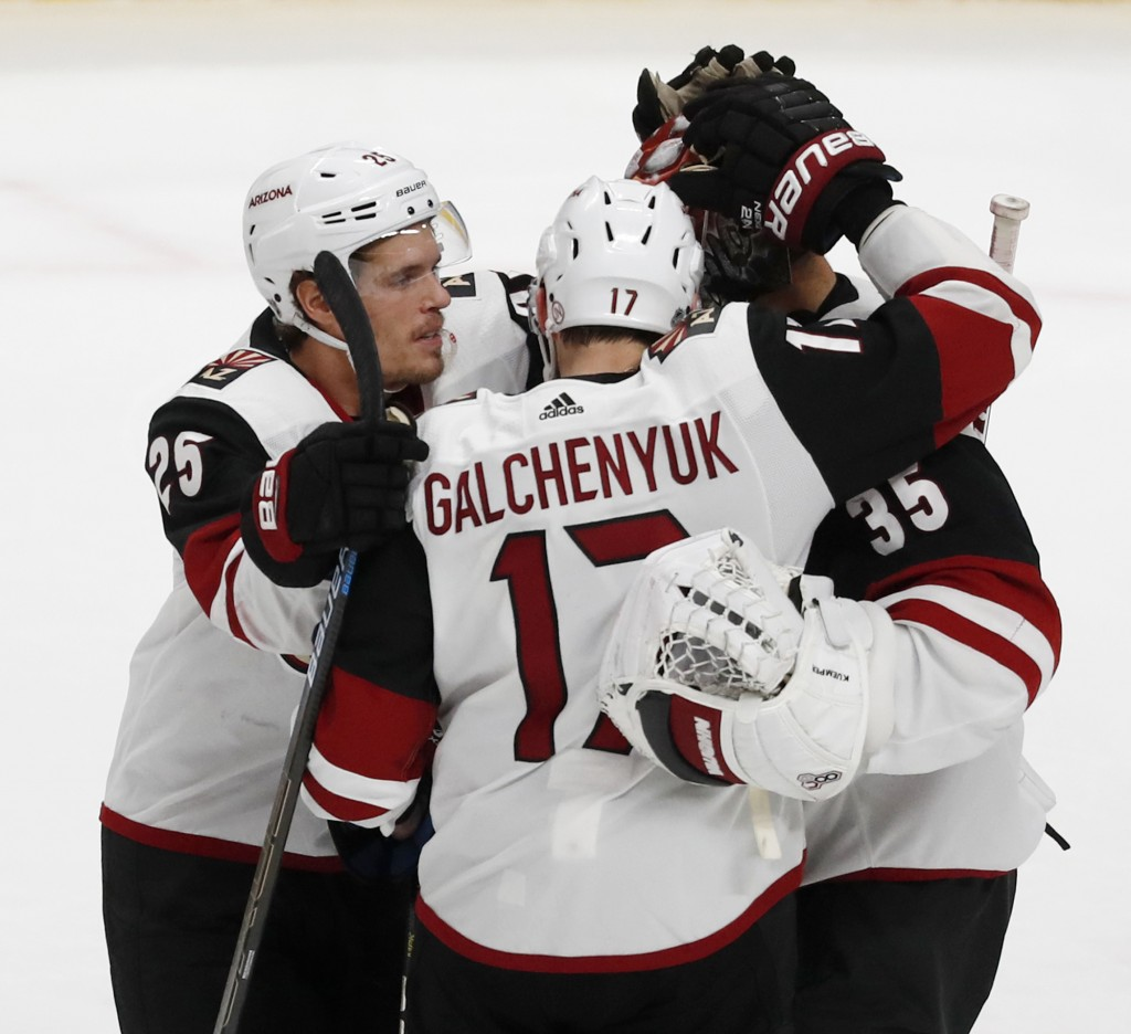 Arizona Coyotes' Nick Cousins(25) and Alex Galchenyuk (17) celebrate an overtime win with goaltender Darcy Kuemper (35) during a shootout of an NHL ho