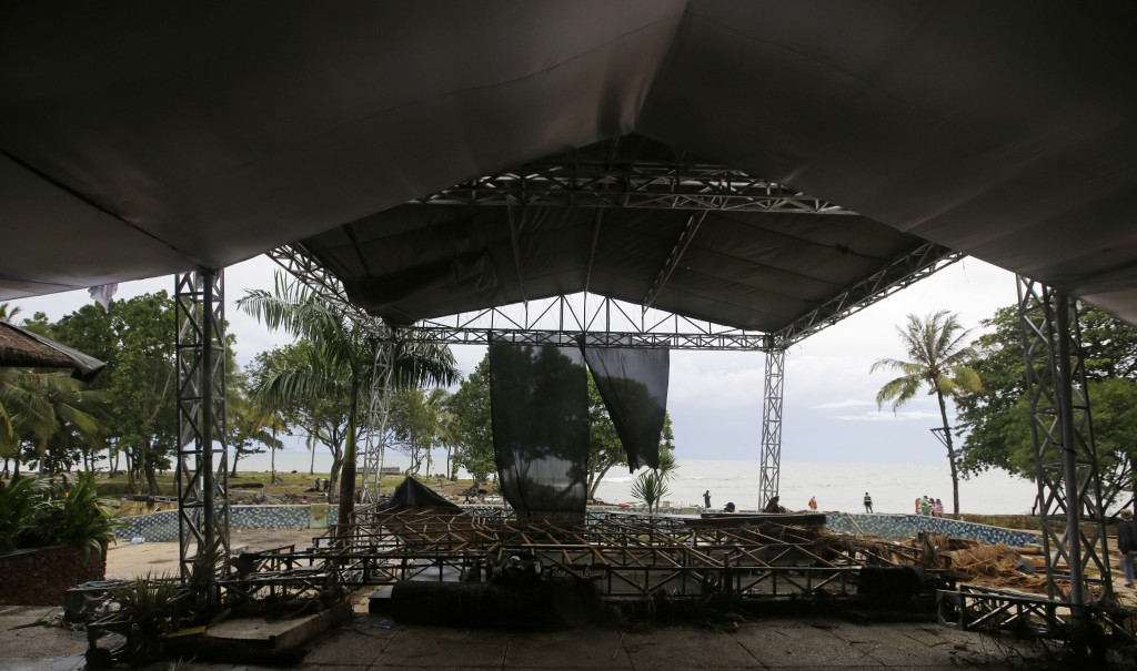 This Monday, Dec. 24, 2018, photo shows a stage destroyed by Saturday's tsunami at a beach resort in Tanjung Lesung, Indonesia. The tsunami that hit t...