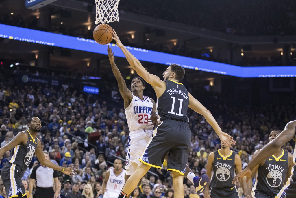 Golden State Warriors guard Klay Thompson (11) blocks a shot by Los Angeles Clippers guard Lou Williams (23) in the second quarter of an NBA basketbal...