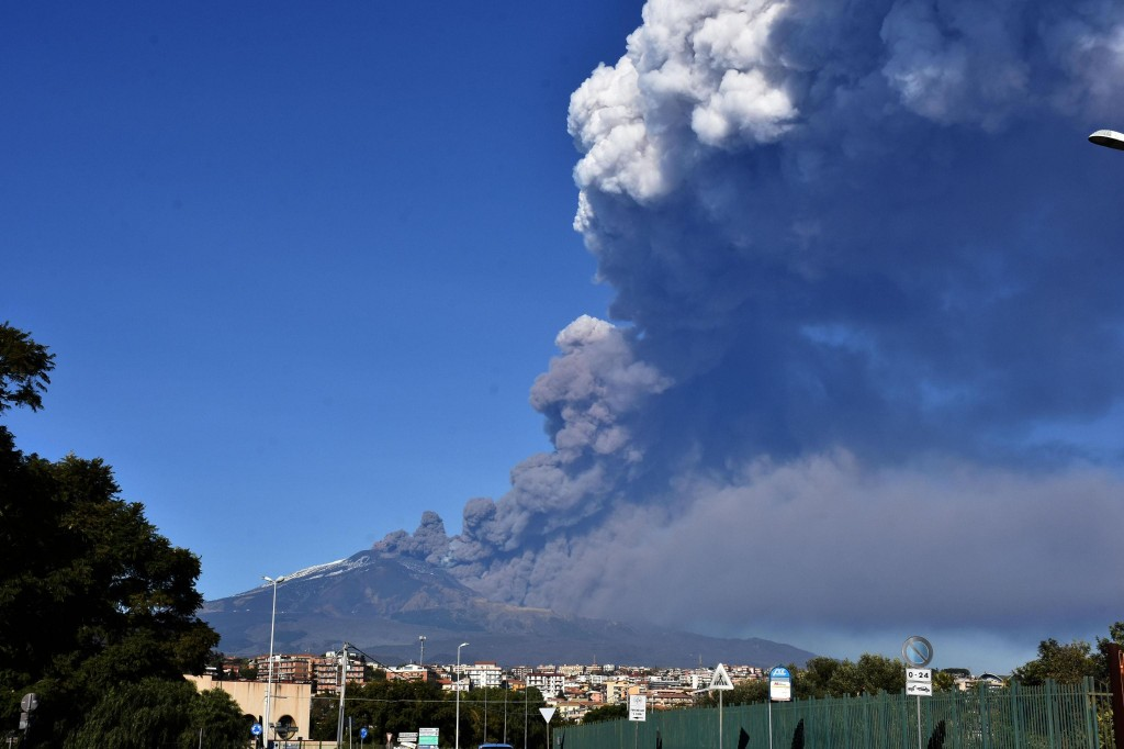 A smoke column comes out of the Etna volcano in Catania, Italy, Monday, Dec. 24, 2018. The Mount Etna observatory says lava and ash are spewing from a...