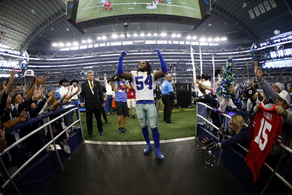 Dallas Cowboys linebacker Jaylon Smith (54) acknowledges cheers from fans as he walks off the field after their 27-20 win over the Tampa Bay Buccaneer...