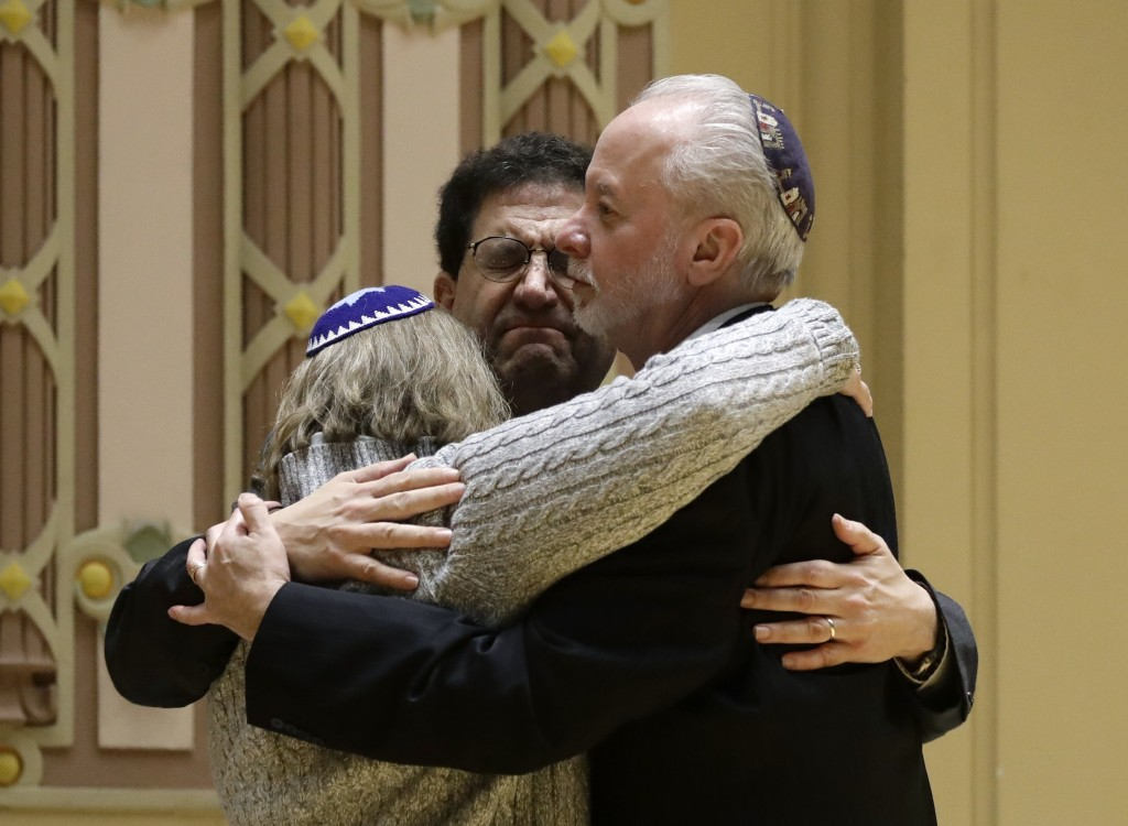 FILE - In this Oct. 28, 2018, file photo, Rabbi Jeffrey Myers, right, of Tree of Life/Or L'Simcha Congregation hugs Rabbi Cheryl Klein, left, of Dor H...