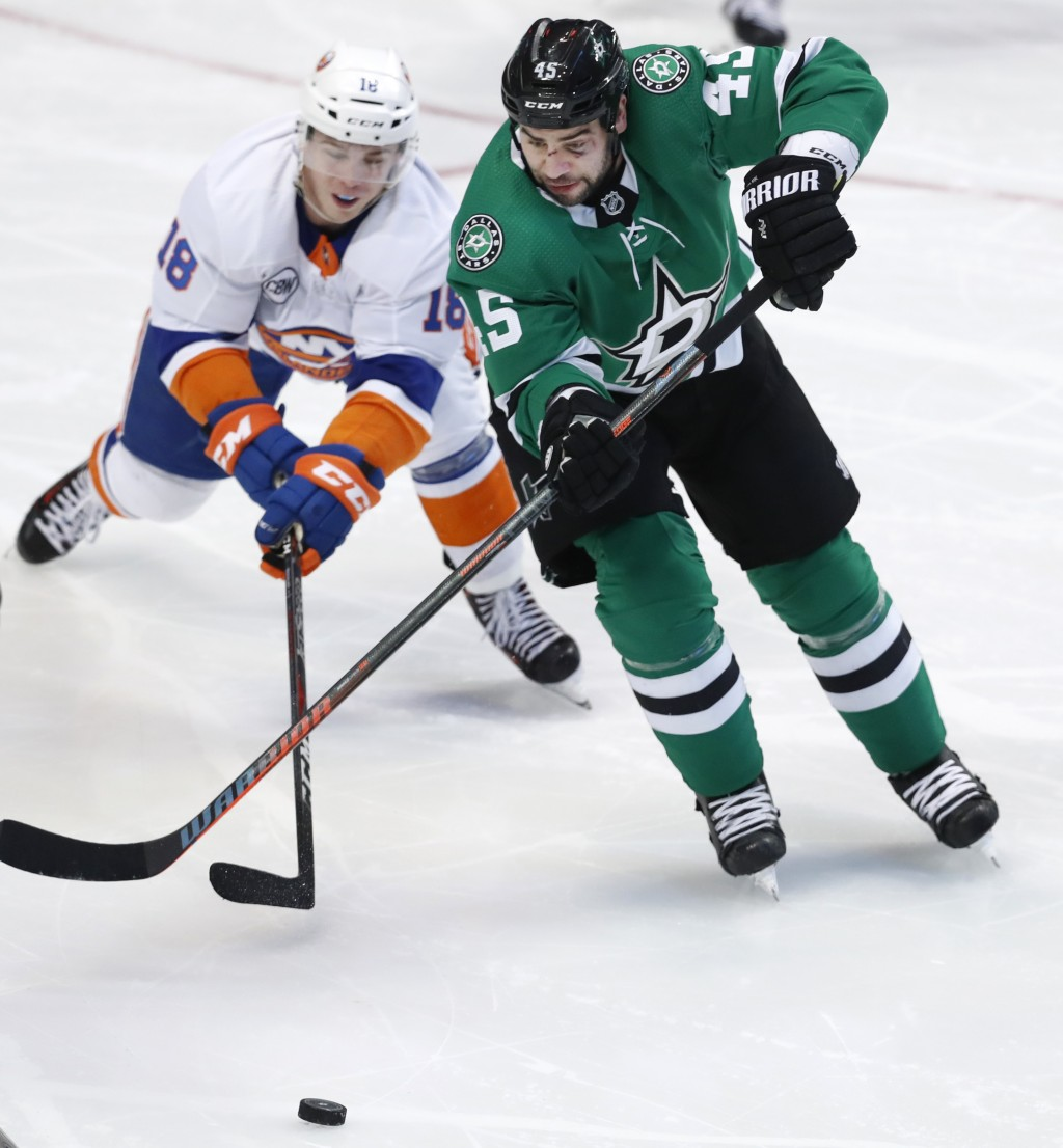 Dallas Stars defenseman Roman Polak (45) skates for the puck against New York Islanders left wing Anthony Beauvillier (18) during the second period of...