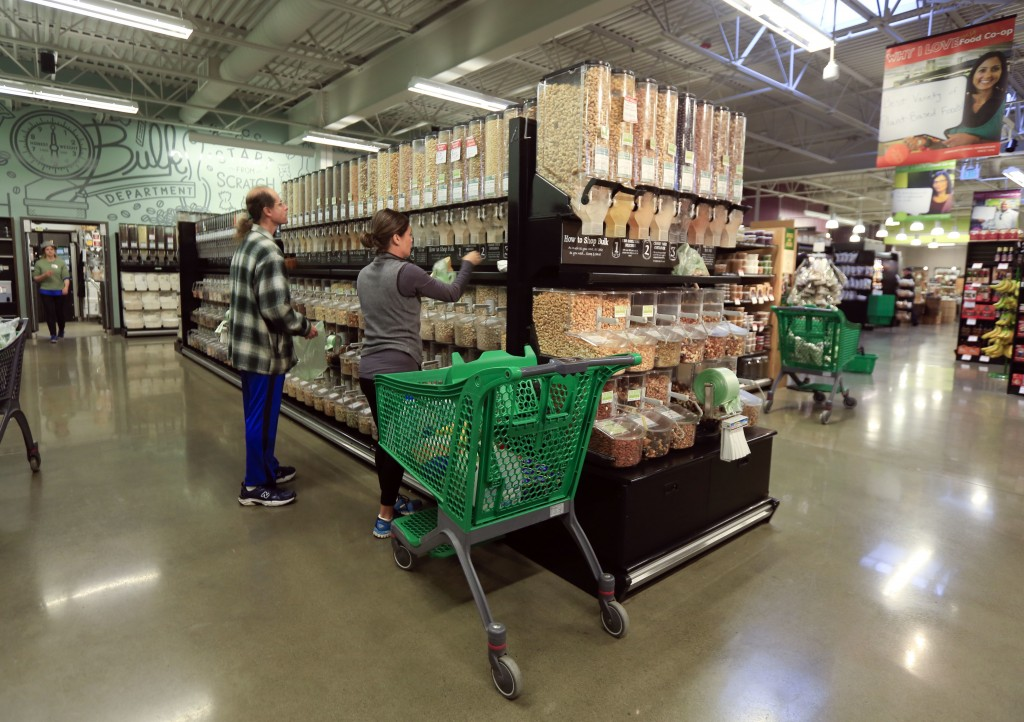 FILE - In this Dec. 15, 2015, file photo, shoppers fill containers in the bulk department at Honest Weight Food Co-Op in Albany, N.Y. There are shortc...