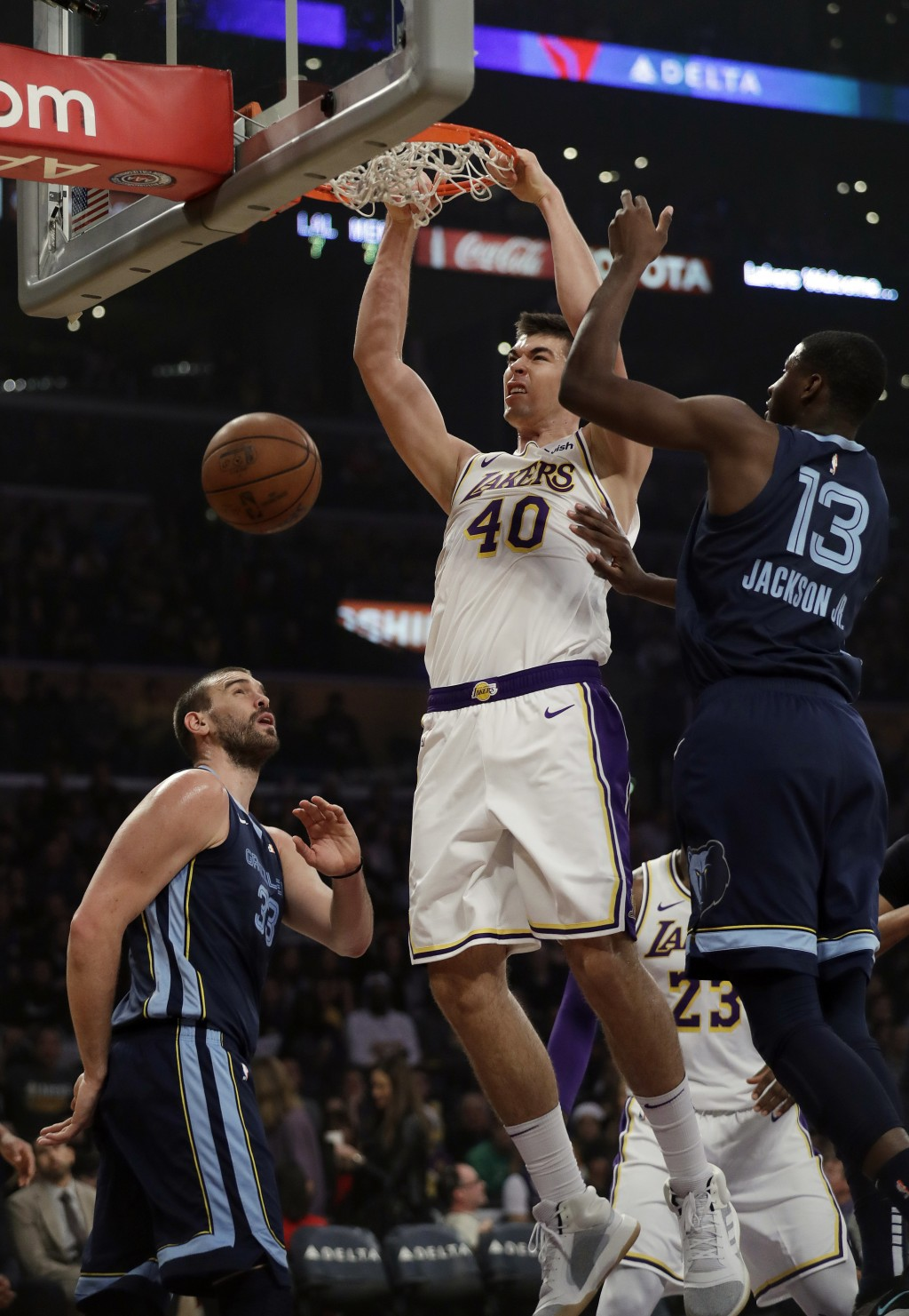 Los Angeles Lakers' Ivica Zubac (40) dunks between Memphis Grizzlies' Marc Gasol, left, and Jaren Jackson Jr. (13) during the first half of an NBA bas...