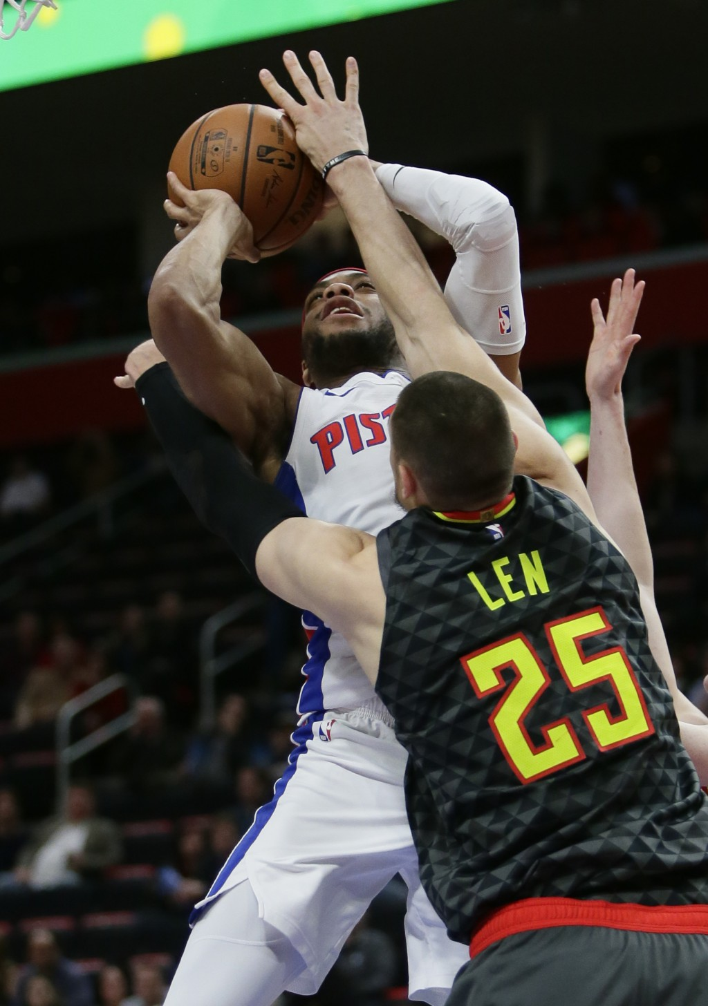Detroit Pistons guard Bruce Brown goes to the basket against Atlanta Hawks center Alex Len (25) during the first half on an NBA basketball game Sunday...