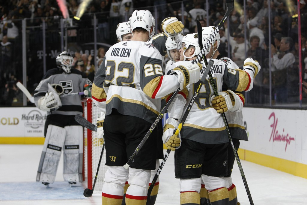 Vegas Golden Knights celebrate after scoring in the second period of an NHL hockey game against the Los Angeles Kings, Sunday, Dec. 23, 2018, in Las V...