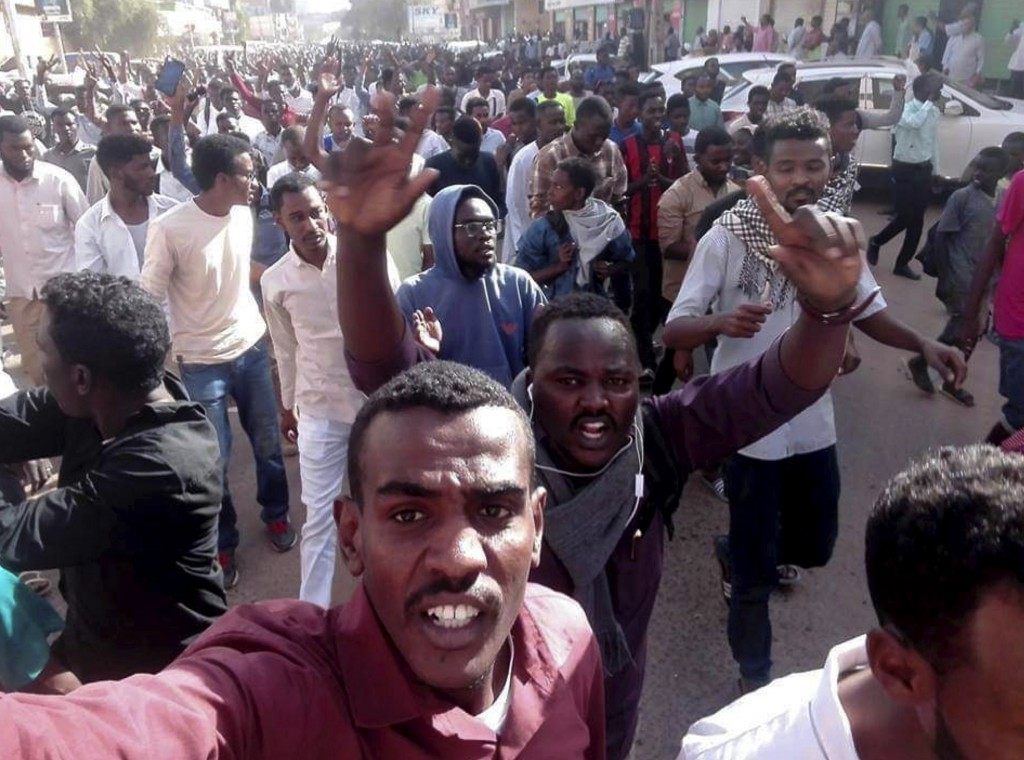 In this Thursday, Dec. 20, 2018 handout photo provided by a Sudanese activist, protesters chant slogans during a demonstration, in Khartoum, Sudan. Th...