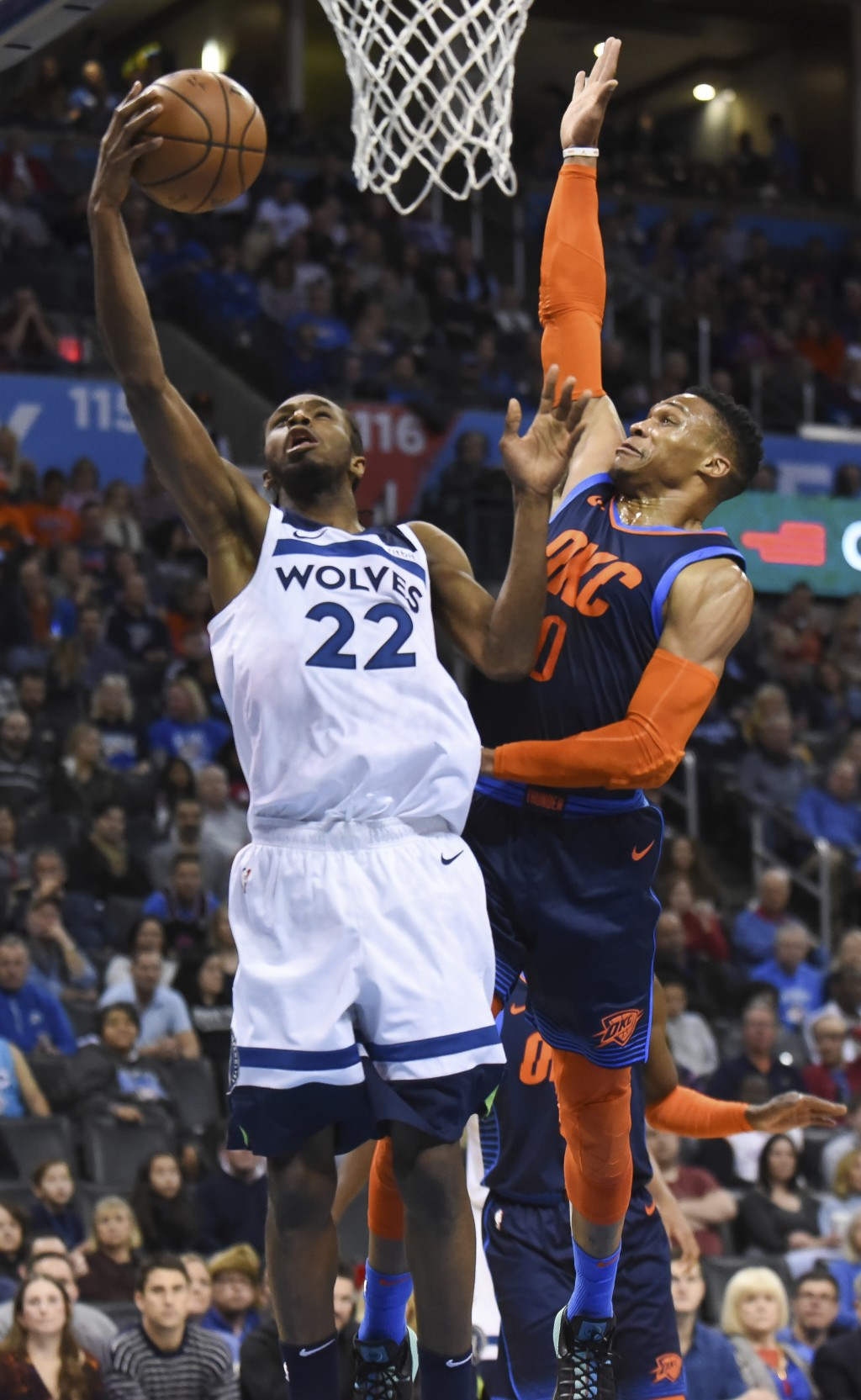 Oklahoma City Thunder guard Russell Wesbrook (0) tries to block a shot by Minnesota Timberwolves guard Andrew Wiggins (22) in the first half of an NBA...