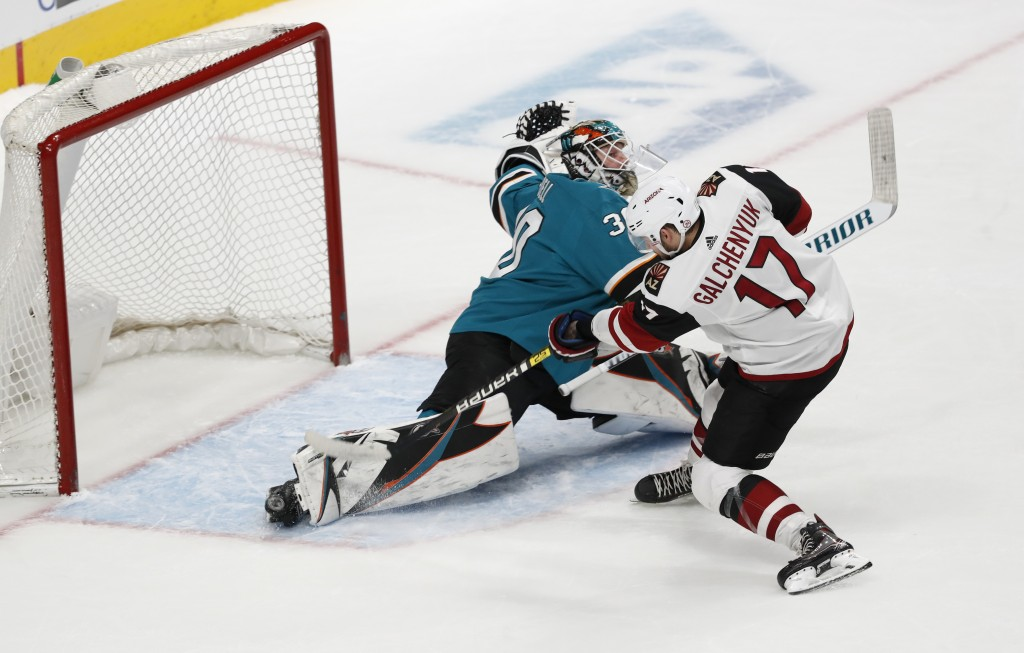 Arizona Coyotes' Alex Galchenyuk (17) scores the game-winning goal during a shootout in an NHL hockey game against San Jose Sharks goaltender Aaron De...
