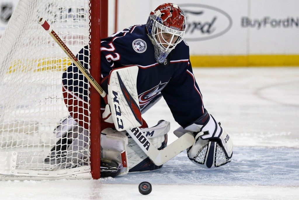 Columbus Blue Jackets goaltender Sergei Bobrovsky (72) watches a shot go wide during the second period of an NHL hockey game against the New Jersey De...